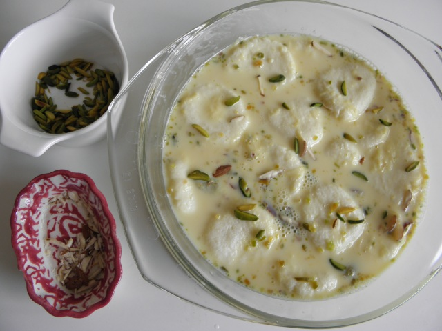 Garnishing Rasmalai with Almond & Pistachio