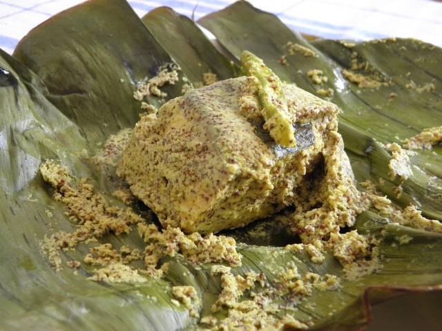 Salmon Paturi or Salmon smoked in banana leaf