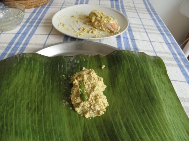 Mustard coated fish on banana leaf