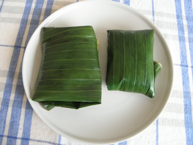 Banana leaf parcels containing the fish