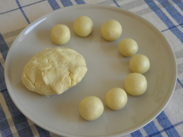 Making of round balls from the dough