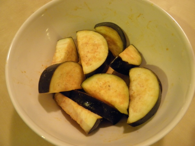 Aubergine slices coated with salt & turmeric powder