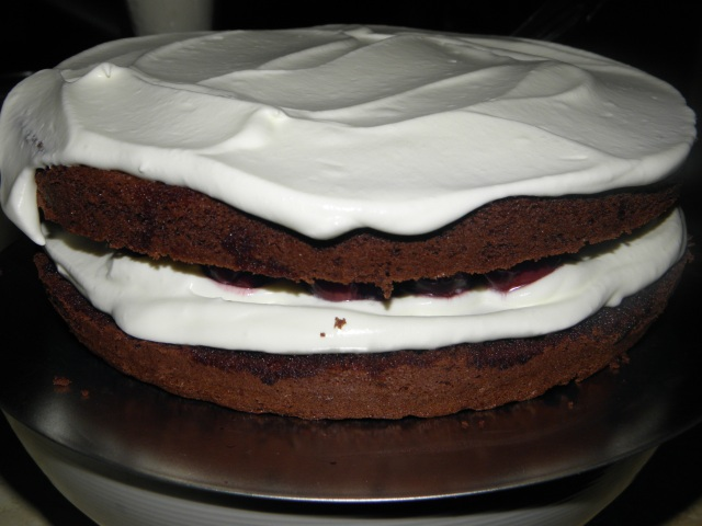 Covering the cake with whipped cream