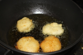 Lentil dumplings are deep frying
